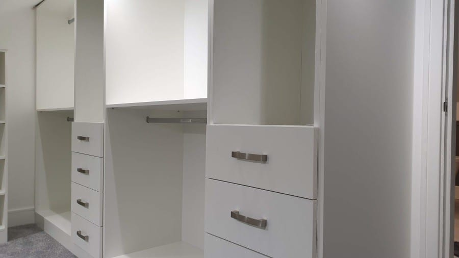 White mat walk in fitted wardrobe