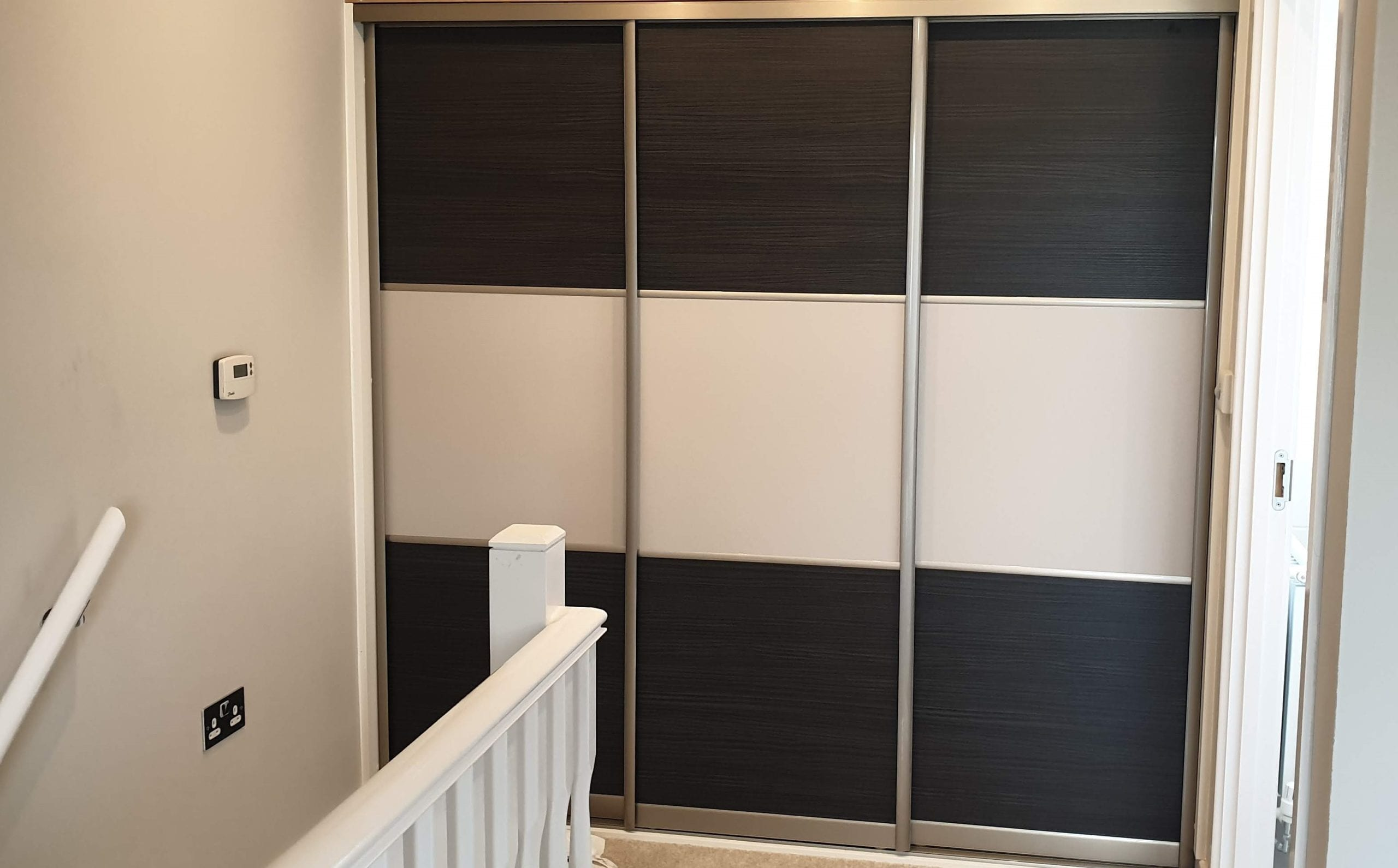 Sliding door wardrobe for the bedroom with sloped ceilng